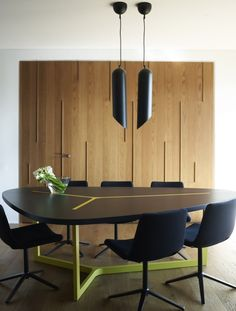 Wicked dining table from Spacelab Architecture designed the interior of this apartment in Athens, Greece