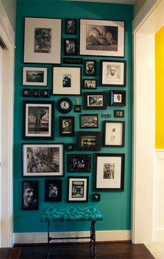 Want a wall with a color and black and white photographs in all different frames. love The foot photo is awesome!