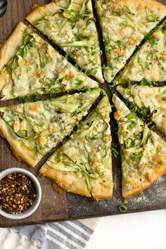 Shaved Asparagus And Gorgonzola Pizza With Asparagus, Scallions, Olive Oil, Cornmeal, Pizza Doughs, Garlic, Mozzarella Cheese, Gorgonzola