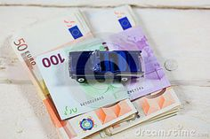 Euro with a car on a wood table