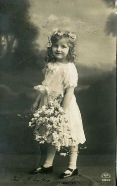 http://www.ebay.com/itm/1910-GERMANY-POSTCARD-REAL-PHOTO-VINTAGE-A-GIRLwith-flowers-/282011621028