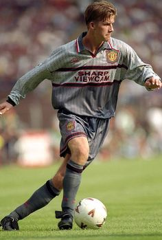 1994: Beckham's first goal for Man U during Champions League. Ugly football kit but what a great pose!  David Beckham