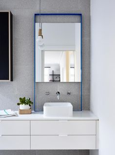 Doherty Design Studio's Sandringham residence ensuite. Bespoke mirror, pendant, floating vanity and terazzo tiles. This project was a collaboration between Doherty Design Studio and Techne Architects.