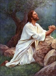 Jesus praying in the Garden of Gethsemane.