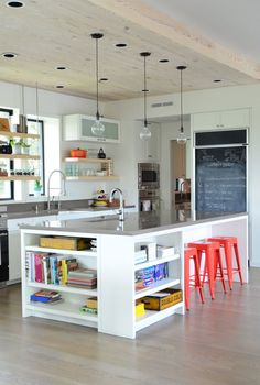 This smart kitchen setup allows diners to eat their breakfast while gazing out the window and/or contemplating the day's to-do list on the chalkboard refrigerator. See more Kitchen Island Breakfast Bar Ideas & Inspiration | Apartment Therapy