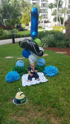 My grandson J-Rick's cake smash shoot. I couldn't wait for the photographer's pictures so I just loaded the ones I took with my mobile phone. #dashinglittleman #cakesmash #grandson #firstbirthday #aruba #marriott