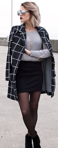 Edgy look | Grey sweater, black skirt, checked coat and ankle boots. Still classy! Love the necklace and jacket.