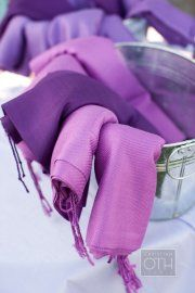 Metal buckets for these lilac shawls makes a lovely and functional display. Check out shawls like these for sale and rent at splendorforyourguests.com!  Splendor for Your Guests | Rental Company | Weddings | Events | Shawls | Blankets | Umbrellas | Parasols | Fans