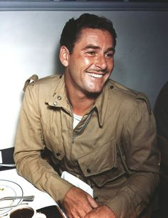 Errol Flynn,not only was he good looking, he had a beautiful smile.