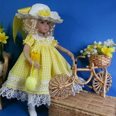 Easter Parade Yellow Gingham Dress with lavish lace, Underskirt and Easter Bonnet with mega bow at the back and Easter Egg and Chic. With daffodil blooms. My Little Darling is wishing she could take a bike ride. Handmade in the UK and sold to USA on facebook.