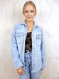 PRE-LOVED denim jacket. Brand / Levi Strauss and Co. Oversized boyfriend style. Light blue denim. 2 pockets on front. Long sleeves. Collar. Buttons down front. Cotton. Size 8-14.