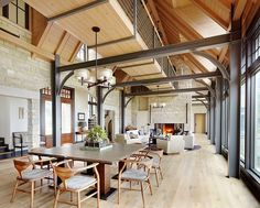 Floors can be dark wood, but the texture contrast of stone, steel and wood, plus the walk ways are pretty cool. I would use wood poles and beams, but perhaps steel around a fireplace and in details-Lake House Retreat by Morgante Wilson Architects