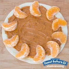 We spread spicy peanut butter on a tortilla and arranged clementine slices to look like sun rays. Do you like to plate your food in a decorative way? #tasteamazing