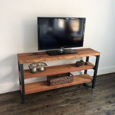The Bradbury Media Unit/Shelving Unit with Reclaimed Wood and Steel by arcandtimber. Available on Etsy $389.00.