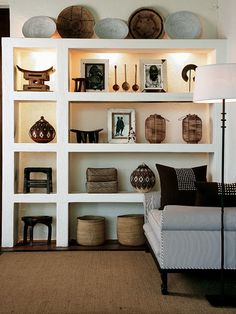 Brilliant way of displaying your collections/artifacts with shelving and hidden lights.    (repinned photo only from Kruger - Londolozi Tree Camp)