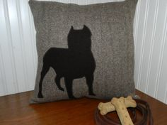 This Pitbull Silhouette Pillow Cover is handmade using 100% upcycled/recycled garments.