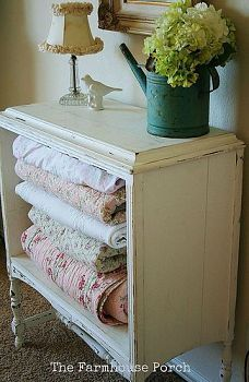 I don't particularly like the style shown but I love the idea of storing blankets in an old dresser w/o drawers.
