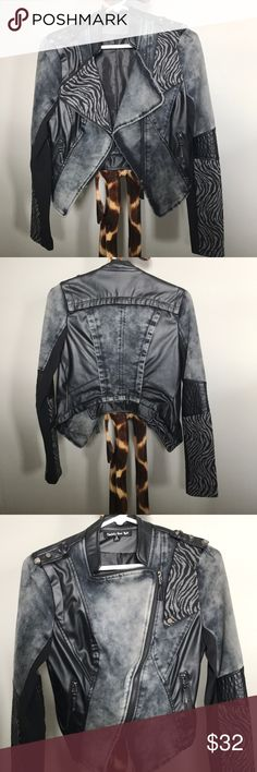 Jacket Black/grey denim jacket with accents of zebra print and pleather.  Nice to wear with a white T-shirt black jeans and a pair of heels. Jackets & Coats