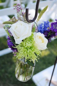 It is possible to incorporate some purple into a cobalt blue, green and ivory wedding theme. It is subtle, but would stand out. Lavender, perhaps?