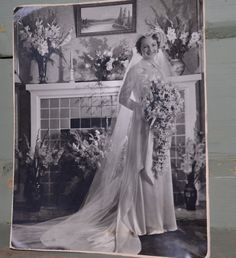 You could set up a table of all old wedding photographs from your family members. ;) - Vintage Wedding Photograph by FleurStreetVintage on Etsy