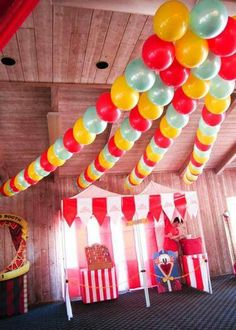 Threaded balloon strings for a carnival theme