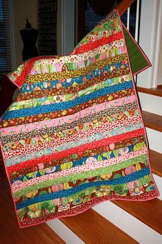 Simple lap quilt made from a Moda Jelly Roll.