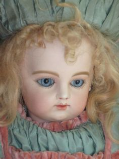 Early F.G. doll with early Bru leather body and bisque arms from antiquedolls6395 on Ruby Lane