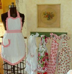 Vintage Aprons on Display- Dress Form & Shabby Green Wooden Pegs