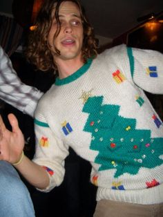 "Matthew in the Christmas sweater he got from the ""Don't Shoot Me Santa"" video he directed for The Killers."