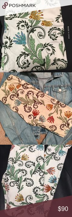 LuLaRoe Os floral paisley LuLaRoe Os leggings made in Indonesia. Cream with blue, pink and yellow floral. Brand new, never tried on. LuLaRoe Pants Leggings