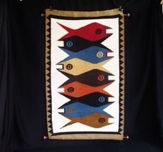 The thing that first caught my eye was the fabulously bold, Mid-Century fish design of this textile wall hanging. What really took my breath away was