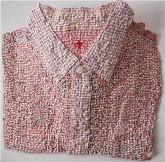John Parkesis an Australian artist who uses pre-used textiles and over works them with complex layers of stitching.