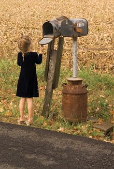 This a beautiful picture of the little girl and the Mail Box's