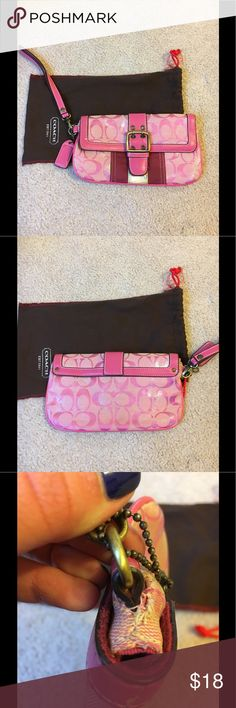 Coach large wristlet Very used, clean inside...damages in pictures Coach Bags Clutches & Wristlets