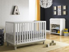Modern white crib for baby boy or baby girl nursery designs from @Bivona & Company Nursery Furniture