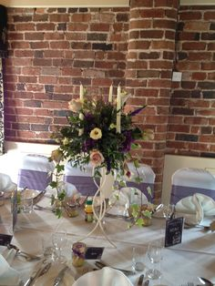 Candelabra finished with Picasso Lilies, Amnesia and Quicksand Roses, Hydrangea Heads, Wax Flower and Veronica
