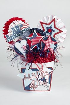 o.k. this one.. well here is what I was thinking.. Fill a white pail with the red filler stuff and put various picks in it (stars)flags etc) you can get the picks from the Christmas tree?