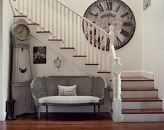 Love the look of the large wall clock and the standing clock.