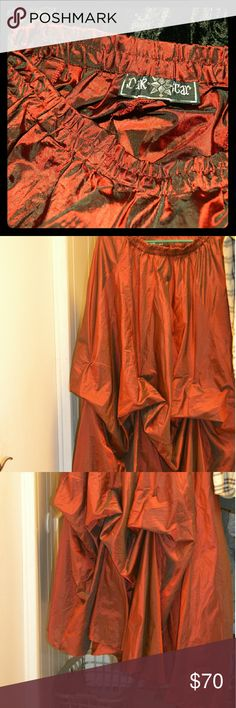 """Skirt Gothic walking skirt. Burgundy, Taffeta material . Can go under or over other skirts. This skirt is also perfect with  corset! The color changes as you walk from Burgundy to black. It is sheer and shiny. This skirt is 39"""" long! About 20"""" waist but elastic waist will give a couple more  inches. It is from England. Dark Star brand and it is beautiful. Only worn twice. Fantastic condition. For tall person or wear heals ;) Some photos taken on velvet cape to show true color. Want cape?? We…"""