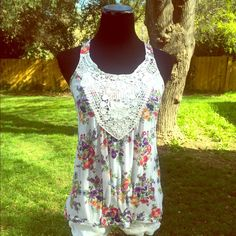 """White Tank w/ Floral Design Beautiful crocheted accent around neckline! Pretty multicolored floral pattern. Lightly worn. In great condition, some tiny piling from wear.           💟My mannequins measurements are 35"""" bust, 26"""" waist, 34"""" hips 💃 Xhilaration Tops Tank Tops"""