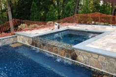 Dreaming of a hot tub? Here's a look at what it might cost to install a jacuzzi to an existing pool and more about spa costs, installation, and options. Pool Landscape Design, Deck Design, Hot Tub Backyard, Pool Remodel, Vinyl Pool, Backyard Patio Designs, In Ground Pools, Pool Landscaping, Water Features