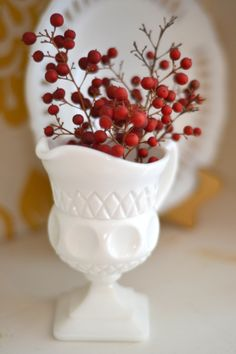 Milk Glass - Homejoy milk glass and red berries make me think of Christmas! www.homejoyblog.com