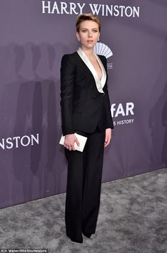 Suited and booted: Scarlett Johansson certainly looked to be all business as she arrived to amFAR on Wednesday night in New York