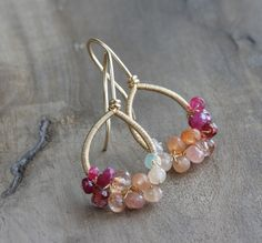 REDUCED FROM £75! { The Honeysuckle Earrings } Delicate wire wrapped all-in-one earrings made with an array of tiny gemstone rondellles in shades of peach, tangerine and hot pink clustered around hand forged teardrop shaped earwires. The total length (including earwires) is 34mm. An *original* KIANDA one-of-a-kind design! { Materials } Micro faceted rondelles of: Welo opal Peach moonstone Sunstone Garnet Ruby Pink spinel All metal used is 14k gold filled { Shipping } UK - Reco...