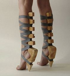 strange wooden heels-these look super painful & more like how to train your self for heel then actual shoes