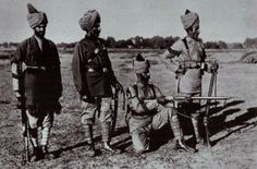 Indian army soldiers a Sepoy in poshteen, an Indian Officer in full dress, a LanceNaik and a Havildar of the Guides