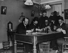 New York card game: A group of men hedge their bets playing cards in the city