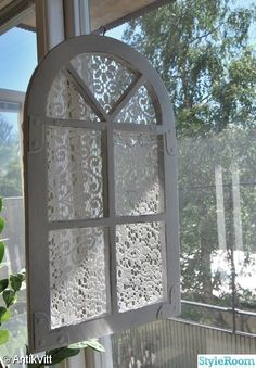Put lace behind the glass of an old window for a cute decoration!