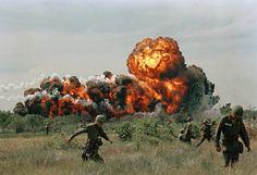 A napalm strike erupts in a fireball near U.S. troops on patrol in South Vietnam in 1966.
