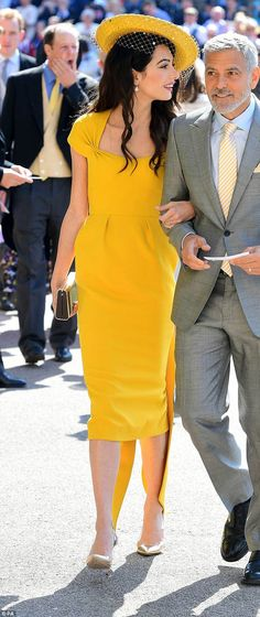87a47a16bf9 Amal Clooney chose a marigold dress by Stella McCartney with a bow at the  back and